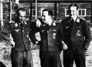 From the left: Ofw. Anton Toni D�bele (94 victories, RK, KIA on 11. November 1943) Uffz. Karl Quax Schn�rrer (46 v., RK) and Ofw. Rudi Rademacher