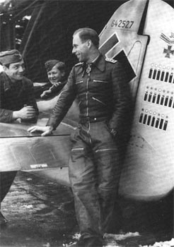 Addi Glunz stands beside his Fw 190A-7