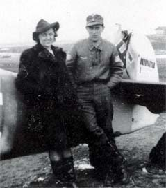 Lt. Alfred Hammer with his mother by the tail of his Bf 109 G-6/R6 Yellow 1
