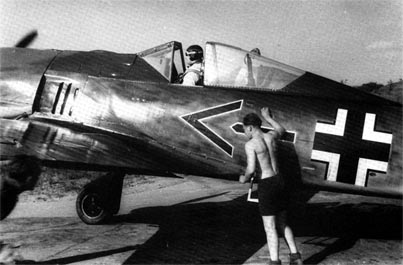 Major Gerd Sch�pfel in his Fw 190A-2 after return from combat sortie. St. Omer, early 1942.