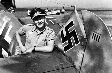 Lt. Gottfried Weiroster with his Bf 109 G-5/R6 (W.Nr. 15 912 ) Red 3 of JGr. 50. The rudder shows four victories over American aircraft.