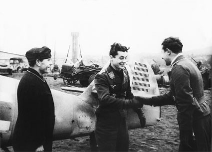 Oberleutnant Robert Weiss of 10./JG 54 receiving congratulations after claiming a victory with his Bf 109 G-6 showing 73 victories. Idriza/Pskov,